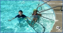 Tyler and friend swimming.